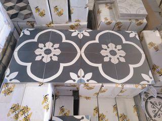 hidraulico porcelanico flor negra 20*20