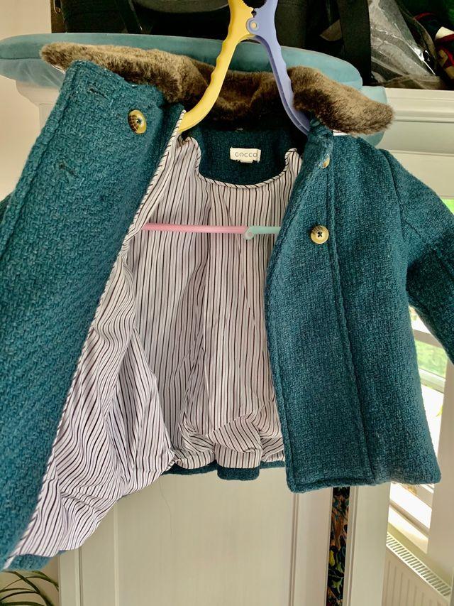 Girl Green trim coat. 6 - 9 months