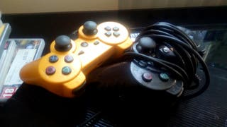 PS3 with Video Games and TWO Dualshock 3 Controls
