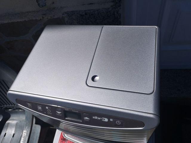 Estufa electrónica de parafina