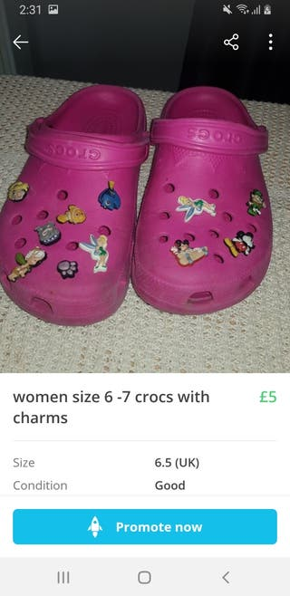 womens size 6-7 crocs pink with charms