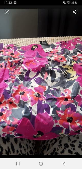 Floral skirt still got tags on
