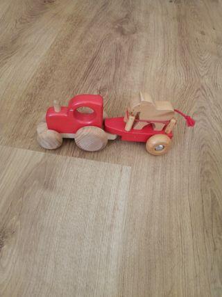 Tractor de madera maciza con libro para niños.