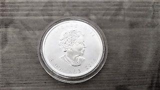 Moneda de 5 dolares, plata.