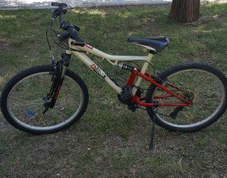 "Bicicleta Rockrider 24""con doblé suspensión niño/a"