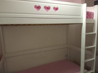 Wooden single bunk bed under Neath space.