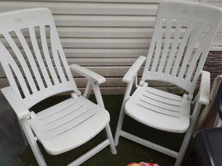 sillas blancas reclinables