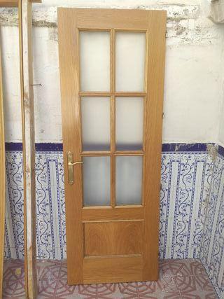 Puerta interior madera y cristal