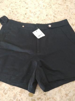 pantalón corto azul marino talla 38, pro más bien