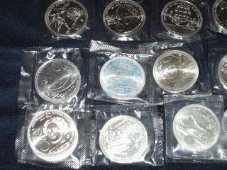 Monedas de 2000 pesetas y 12€. Plata.