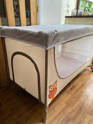 Brand new travel cot
