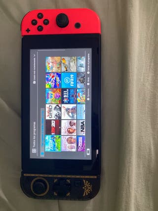 Nintendo switch con 23 juegos más accesorios