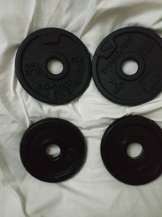 4 discos(de 1kg) de fundicion 28mm. Gimnasio