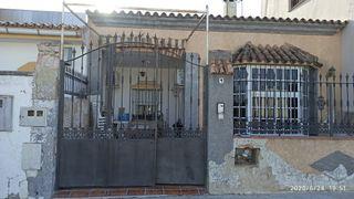 puerta garaje hierro forjado y valla