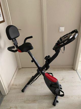 Bicicleta estática plegable con respaldo