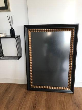 Marco dorado y negro con cristal