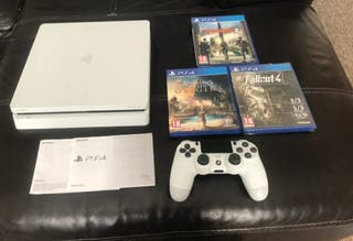 ps4 in white w games and controller
