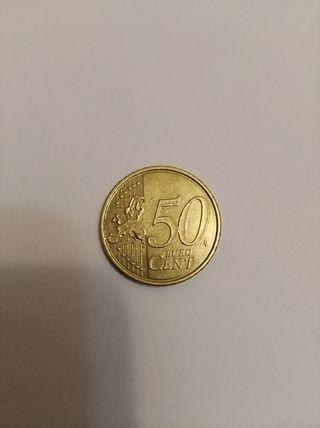 moneda de 50 cent empastada