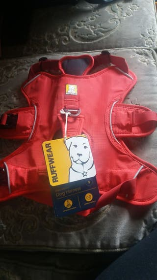 Various Ruffwear and Barbour pet harnesses