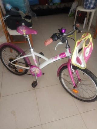 Bicicleta niña de cinco a diez años.