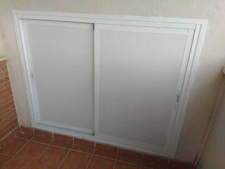 Puerta aluminio armario terraza