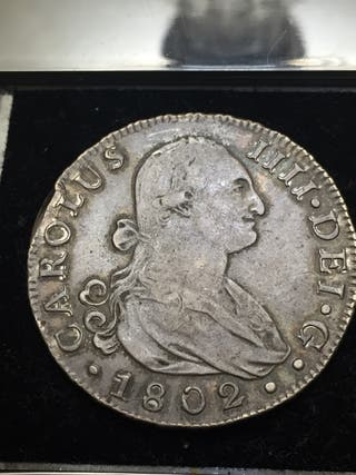8 reales Carlos IIII 1802 ceca Sevilla escasa