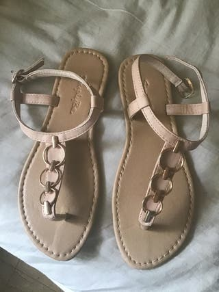 Creame sandles never been worn size 5