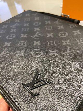 BOLSO DISTRICT MM Louis Vuitton mochila