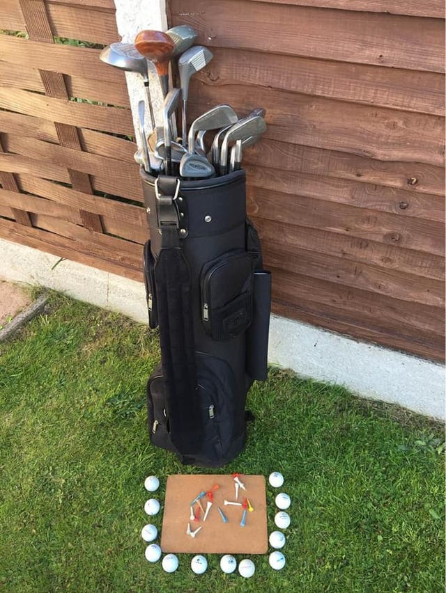 Golf bag with clubs and golf balls