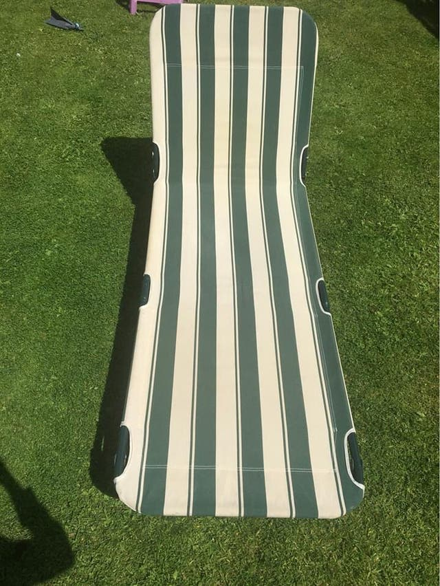 Green and white reclining sun lounger