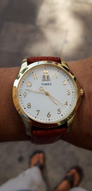Reloj Timex calendario ,correa nueva oroginal