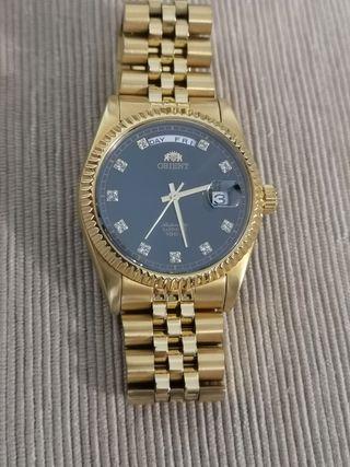 Orient dorado estilo Rolex president.