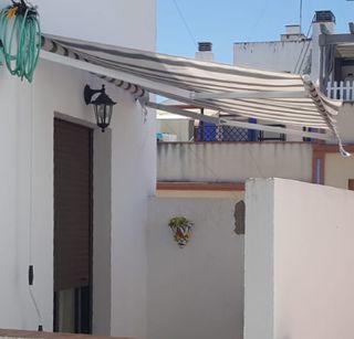 Toldo manual para terraza