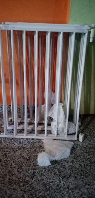 Puertas seguridad Munchkin bebés y niños