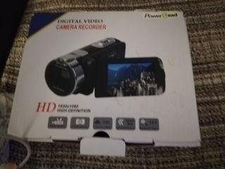 cámara video HD con trípode