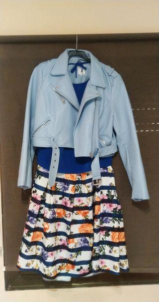 conjunto compuesto de cazadora,top y falda