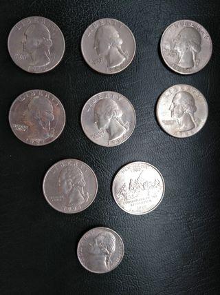 Cuatos de dolar y una monda de 5 centavos