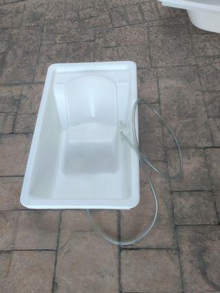 bañera con tubo de desagüe