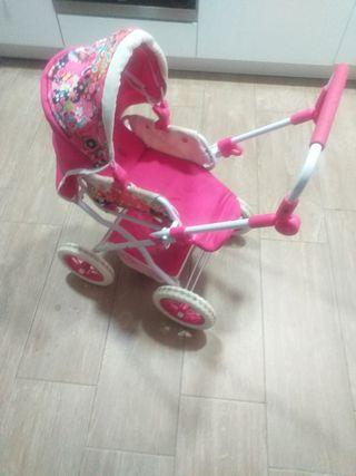 Carro para muñecas de color rosa