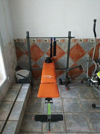 banco gimnasio para pesas, piernas y brazos.