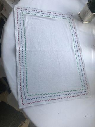Mantel individual de tela