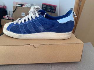 Adidas superstar azul y blancas