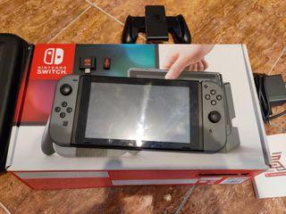 Nintendo switch + Funda + muchos juegos