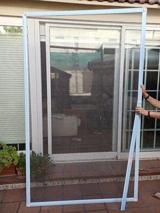 Mosquitera corredera puerta jardin