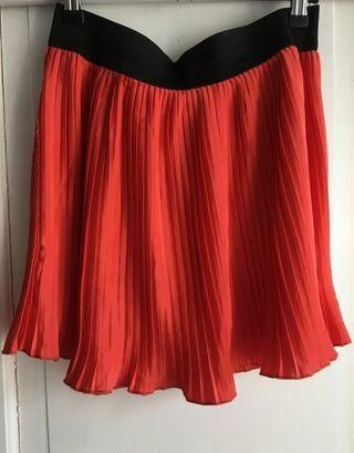 minifalda plisada rojo anaranjado