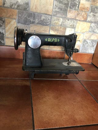Máquina antigua coser alfa