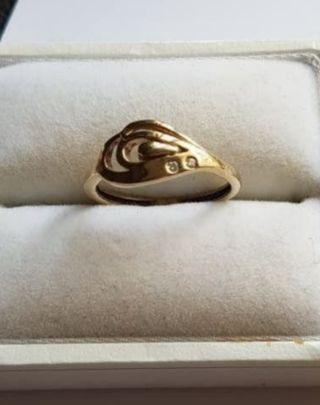 anillo de oro 18kt y circonita