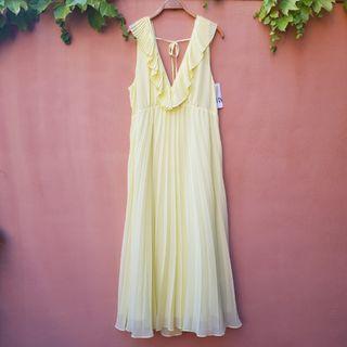 Vestido largo amarillo plisado Zara