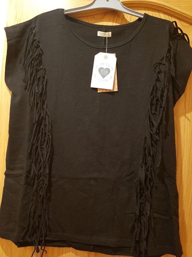 Camiseta negra, Nueva a estrenar