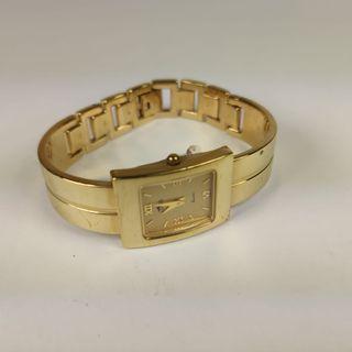 Reloj Lotus chapado oro